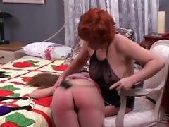 cute lesbian floozy mistress spanks the hell out